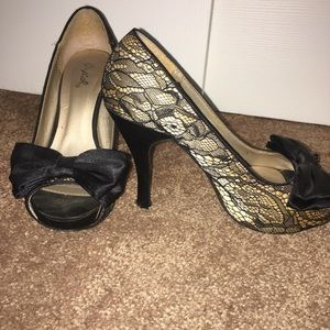 Super cute Qupid heels with lace and bow detailing